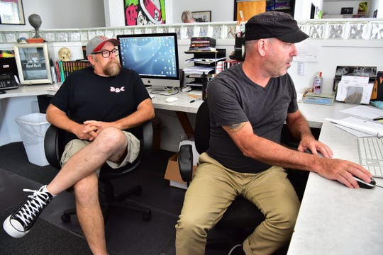 Weird New Jersey magazine's co-founders Mark Sceurman and Mark Moran pose for a photo in their office in Little Falls. The magazine recently published its 50th edition, marking 25 years of covering the weirdest stories of New Jersey.