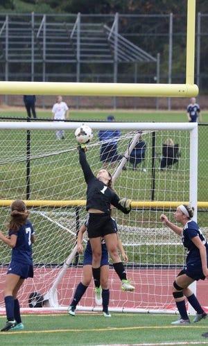 Senior Danielle Laky, center, returns in goal for the Pequannock girls' soccer team after recording 298 saves last fall.