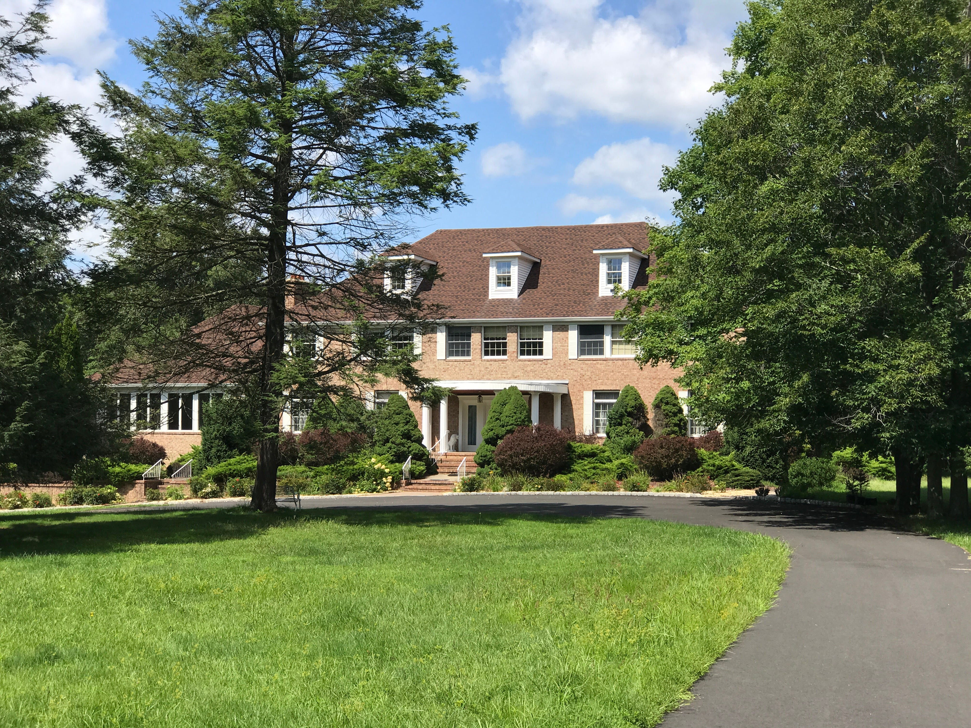 A look at a million dollar home for sale on 20 acres of secluded property in the woods in West Milford. The brick colonial at 828 East Shore Road was built in 1983 and features a grand ballroom and an indoor handball court. It has six bedrooms and five-and-a-half baths and is a five minute walk from Greenwood Lake.