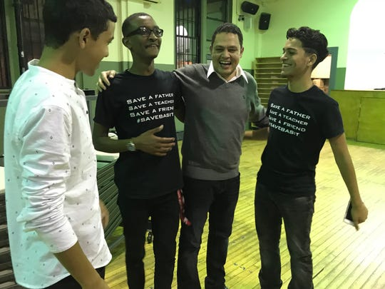 Ahmed Abdel-Basit, freed from immigration detention, laughs with his students from Rising Start Academy. They are Ali Eldeeb, Hassan Elsaid and Yusef Haddabah.