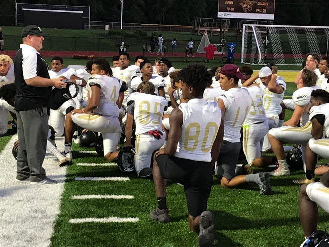 Paramus Catholic coach John Whitehead talks to his team after it's scrimmage win over St. John Vianney.