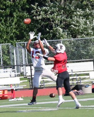 William Robinson (white jersey) of Bloomfield making a catch in a game scrimmage against West Essex on Aug. 23.