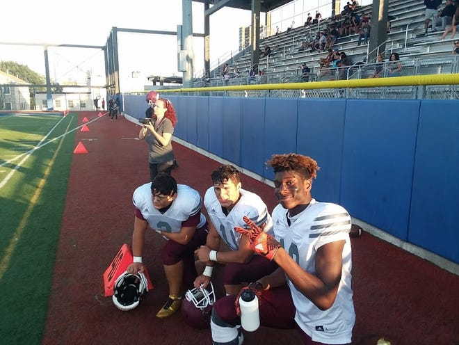 Wayne Hills' (from left) Anthony Puntolillo, Jaaron Hayek and Charles Njoku take in the action during second half of game scrimmage at Union City on Aug. 23.