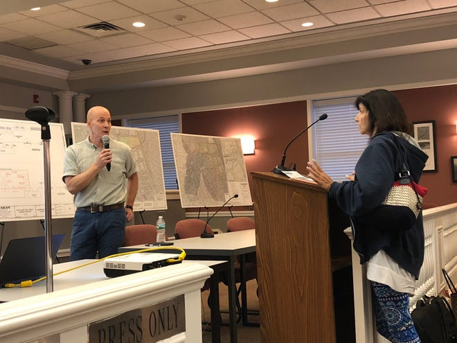 EPA Project Manager Michael Zeolla answers questions about a plan to upgrade a water filtration system in Fair Lawn.