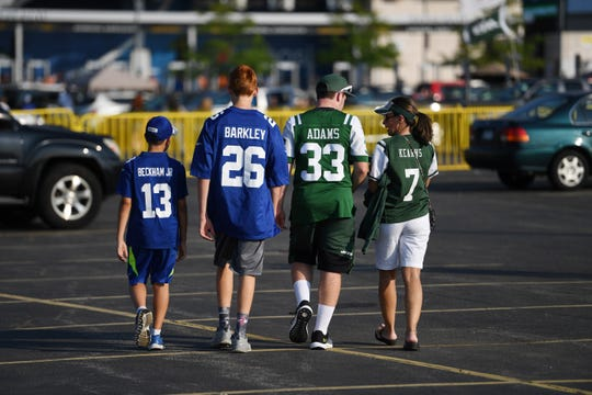 Giants vs. Jets preseason game at MetLife Stadium in East Rutherford on Friday, August 24, 2018. Giants and Jets fans in the parking lot before the start of the game.