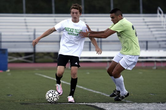 Brayden Schwartz, left, battles Emilio Quevedo during a Pascack Valley soccer practice in 2016.