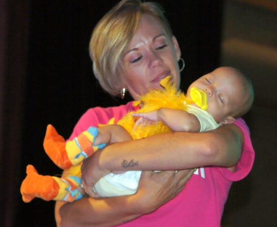 Babies are a big draw at the Mizkan America Duck Royalty Pageant.