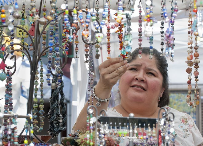 Michelle Hernandez of Anthony Texas checks out some of the bracelets from the Tamajesy Roar booth at a previous Franciscan Festival of Fine Arts at the Holy Cross Retreat Center in Mesilla Park.