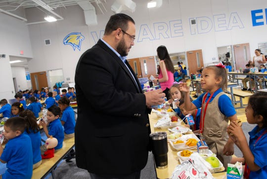 Ernesto Cantu, executive director of IDEA Public Schools in El Paso, interacts with a kindergarten student during lunch time at the IDEA Edgemere on its second week of operation in east El Paso on Monday, Aug. 20, 2018.