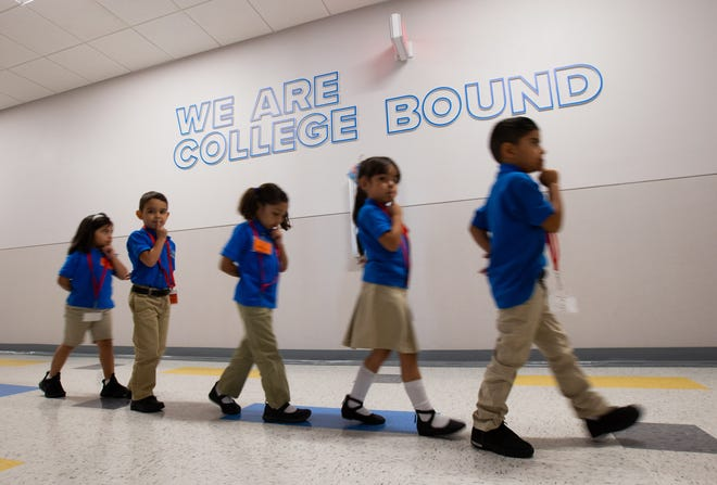 Kindergarten students walk to class at the IDEA Edgemere public school on its second week of operation in east El Paso on Monday, Aug. 20, 2018.