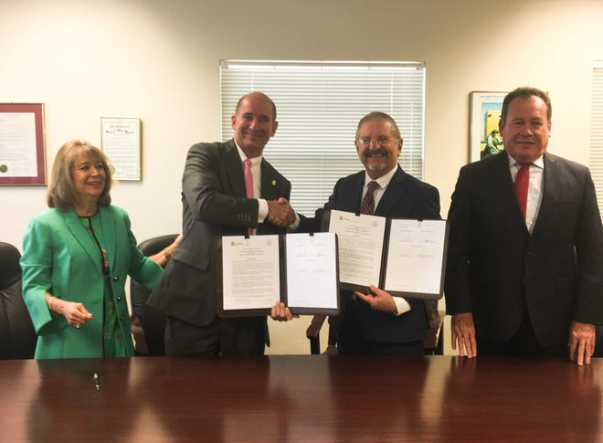 Western New Mexico University President  Joseph Shepard celebrates the signing of four general collaboration agreements with higher education institutions in Sonora, Mexico. Pictured from left are New Mexico Secretary of Education Barbara Damron, Shepard, Instituto Tecnológico de Sonora Rector Dr. Javier José Vales and Sonora Undersecretary of Education Maestro Onésimo Mariscales.