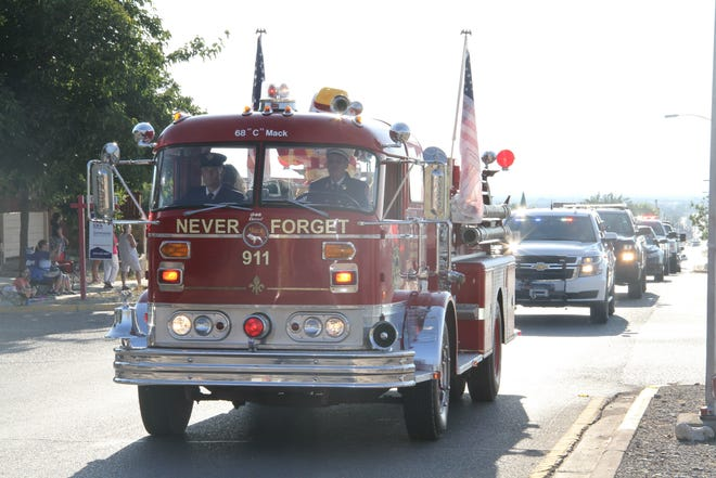 United We Stand spokesman Archie Koenemund drives his restored a 1968 Mack C Model fire truck  in memory of the first responders and victims in the United We Stand parade in 2017.