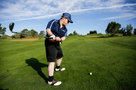 Donald Scott Patterson begins his backswing Friday during the Special Olympics New Mexico Four Corners Invitational at the Pinon Hills Golf Course in Farmington.