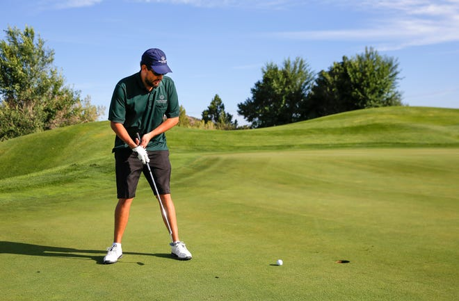 Athlete Nick Sylvester putts Friday, Aug. 24, 2018, during the Four Corners Invitational at the Pinon Hills Golf Course in Farmington. The course is among public facilities the City of Farmington will reopen on Dec. 2 with COVID-19 restrictions in place.
