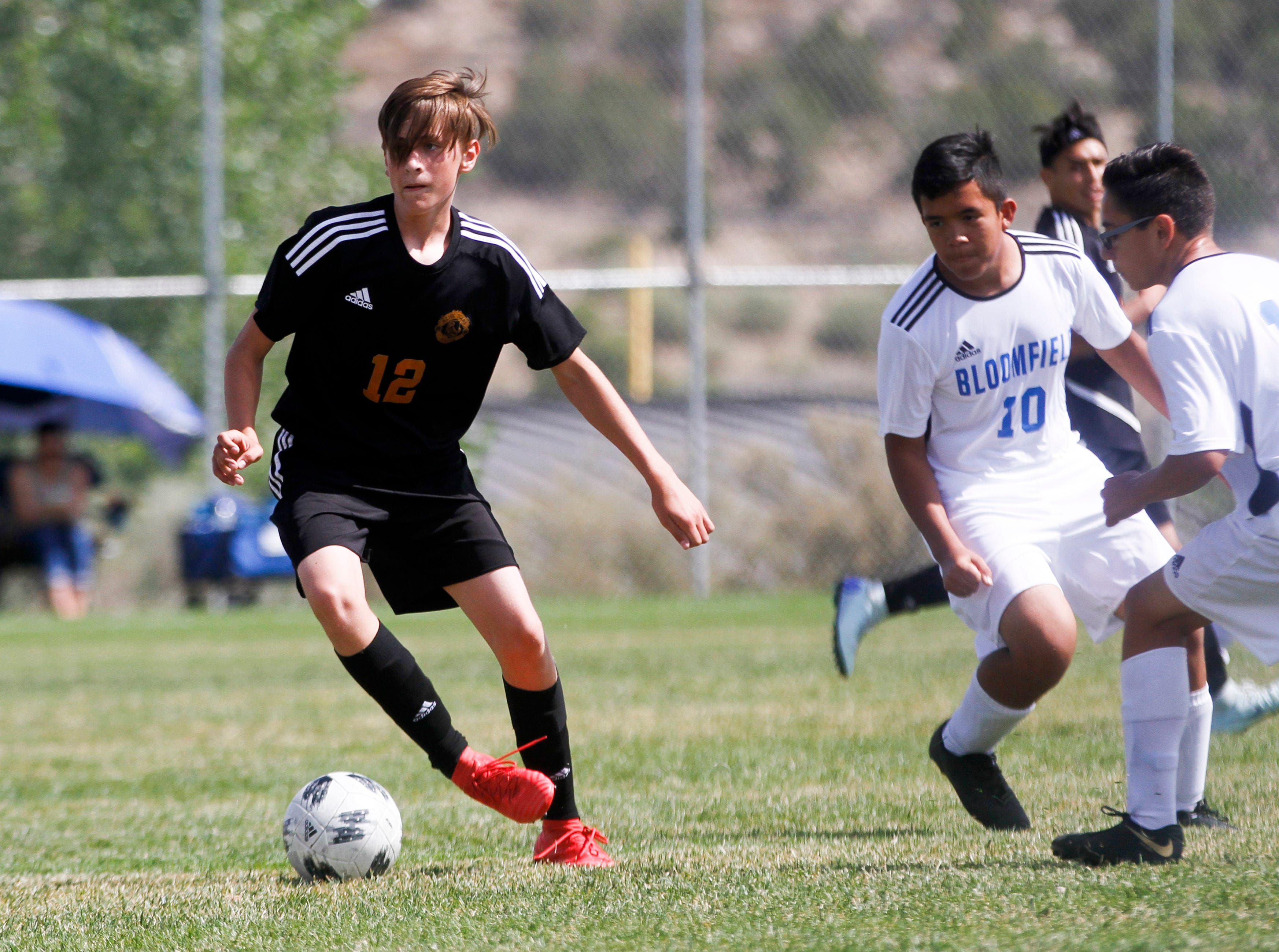Aztec's Kolton Bruhn takes possession of the ball, Friday, Aug. 24, 2018 at the Aztec Tiger Soccer Complex.