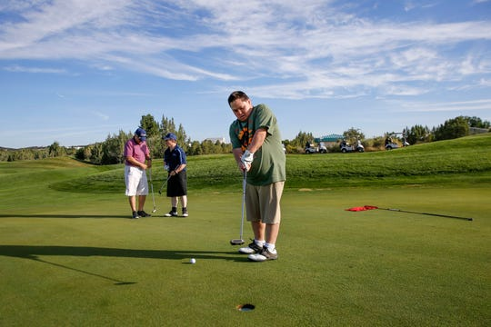 Nathan Valdez practices his putting Friday during the Special Olympics New Mexico Four Corners Invitational at the Pinon Hills Golf Course in Farmington.