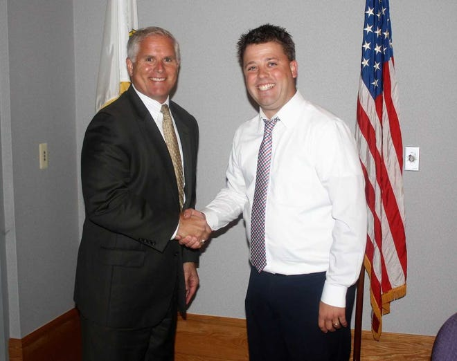 Paul Zelenak (left) is congratulated by South Lyon mayor Dan Pelchat.