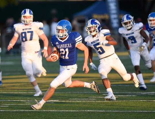 Detroit Catholic Central's Keegan Koehler scores one of his two TDs in a season-opening 28-7 win over Walled Lake Central in the Xenith Prep Kickoff Classic at Wayne State.
