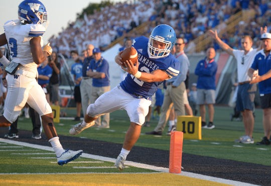 Detroit Catholic Central's Bryson Trantham scores the game's first TD after after it was set up by Keegan Koehler's 55-yard in the first quarter.