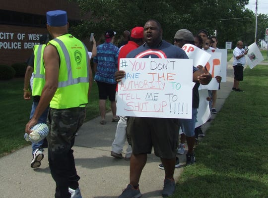 The march outside Westland police headquarters Friday drew about 50 people at its peak.