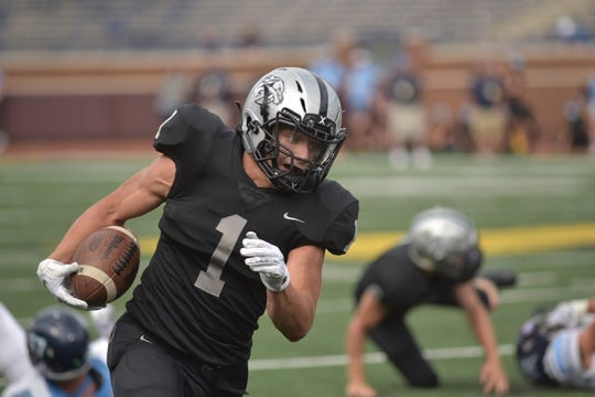 Plymouth's Mike Mathias scampers towards the end zone during the second quarter Friday.