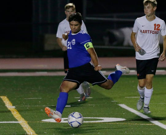 Oshkosh West's Edgar Heredia kicks the ball in for a score late in the game against Hartford on Thursday.