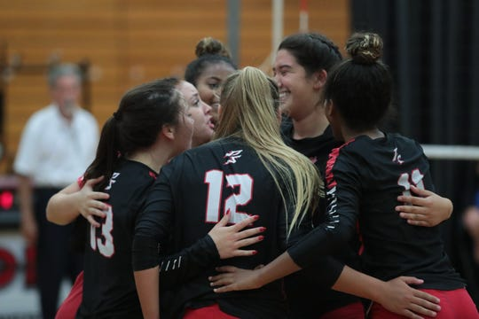 Palm Springs players celebrate after a point against Cathedral City at Palm Springs High School, August 23, 2018.