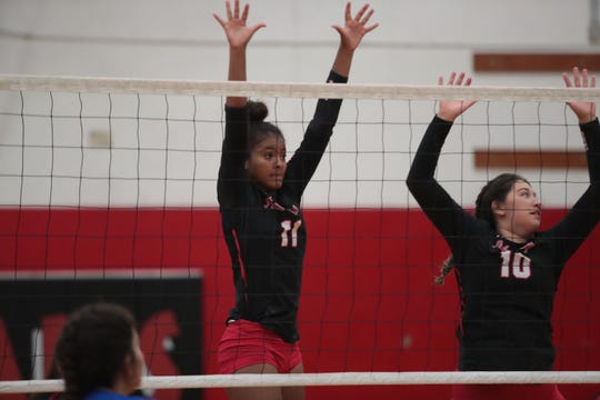Maricela Wright, left, and Natalia Zavala jump to block a spike from Cathedral City at Palm Springs High School, August 23, 2018.