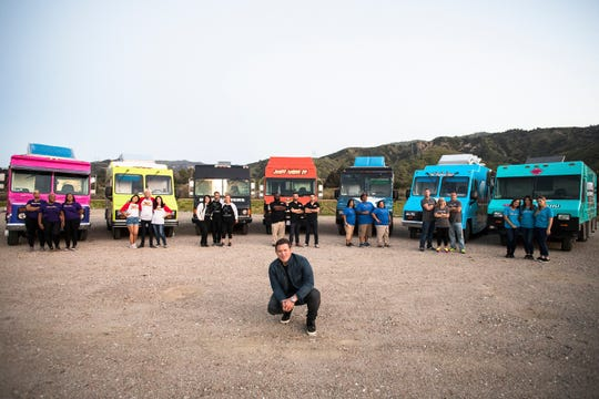 Buns Thighs , Chop Shop, Heroes On A Half Shell, Just Wing It, Mobile Moo Shu, New England Grill, and Sassy Soul team members in front of their trucks with host Tyler Florence, as seen on The Great Food Truck Race, Season 9.
