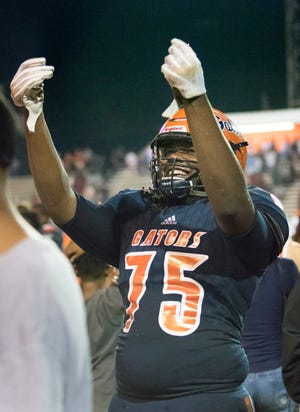 Escambia High School offensive lineman Aric Harris celebrates after a win over West Florida High on Aug. 23.
