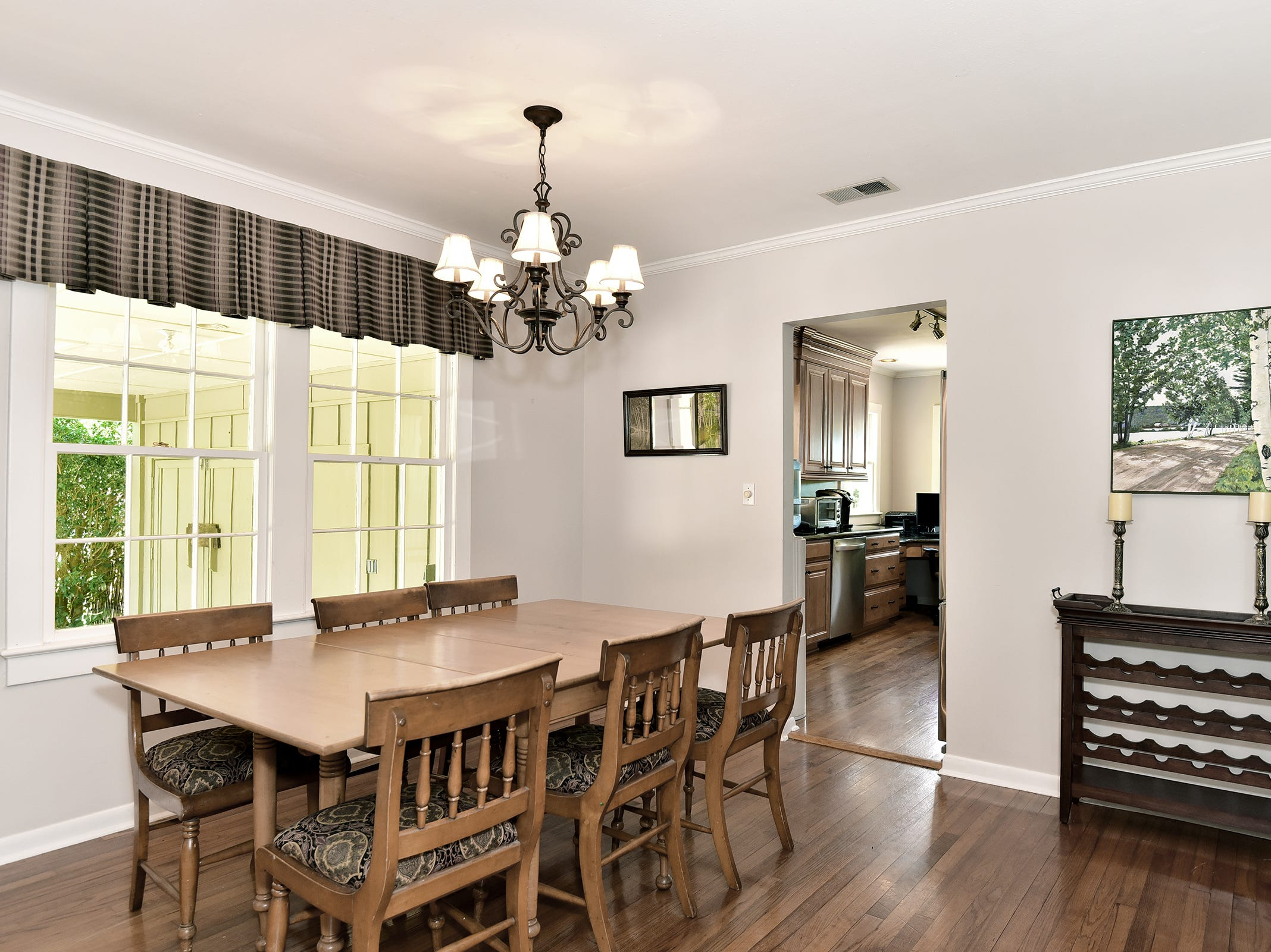 1812 Magnolia Avenue, the dining area flows into the kitchen.