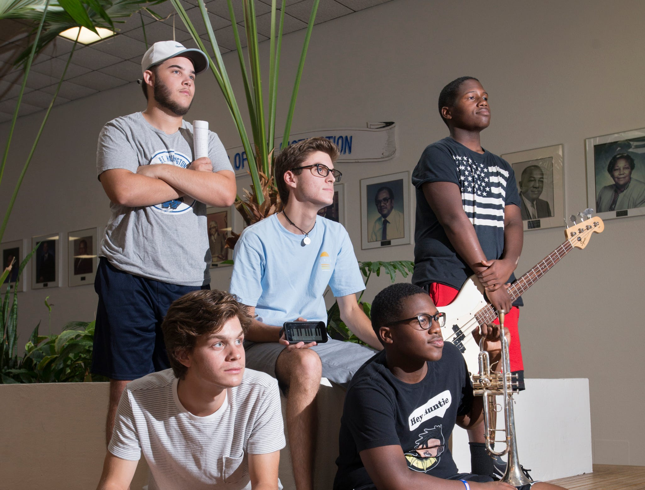 Soul Station jazz band members - saxophonist Noah Hall, clockwise from top left, keyboardist Bryce Lyublanovits, bass guitarist Andre Conner, trumpeter Andrew Conner, and drummer Chase Rogers pose in the atrium at Booker T. Washington High School in Pensacola on Friday, August 24, 2018.
