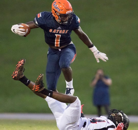 Frank Peasant (1) carries the ball during the West Florida vs Escambia football game at Escambia High School in Pensacola on Thursday, August 23, 2018.