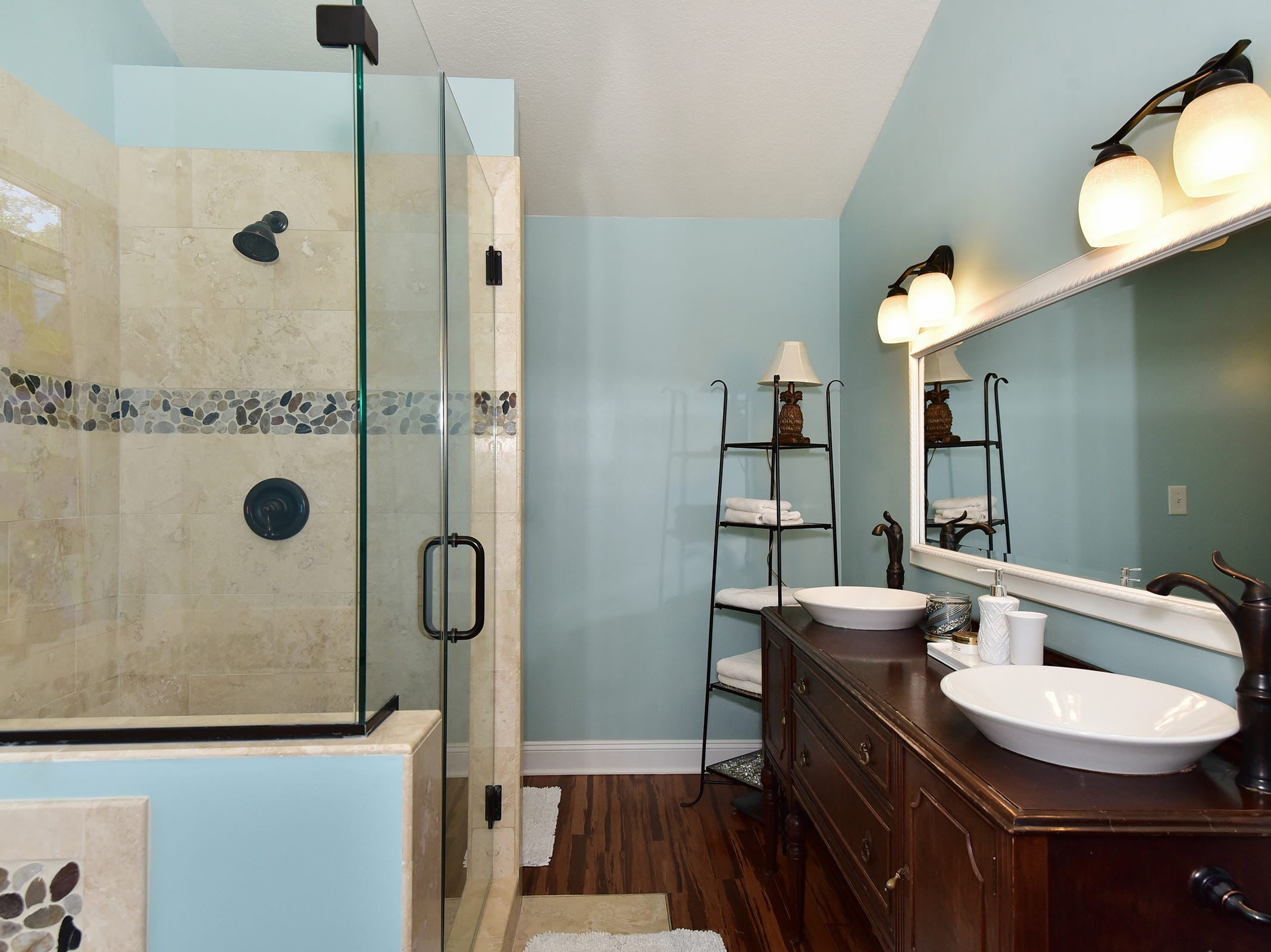 1812 Magnolia Avenue, the master bath includes bowl sinks and a walk-in shower.