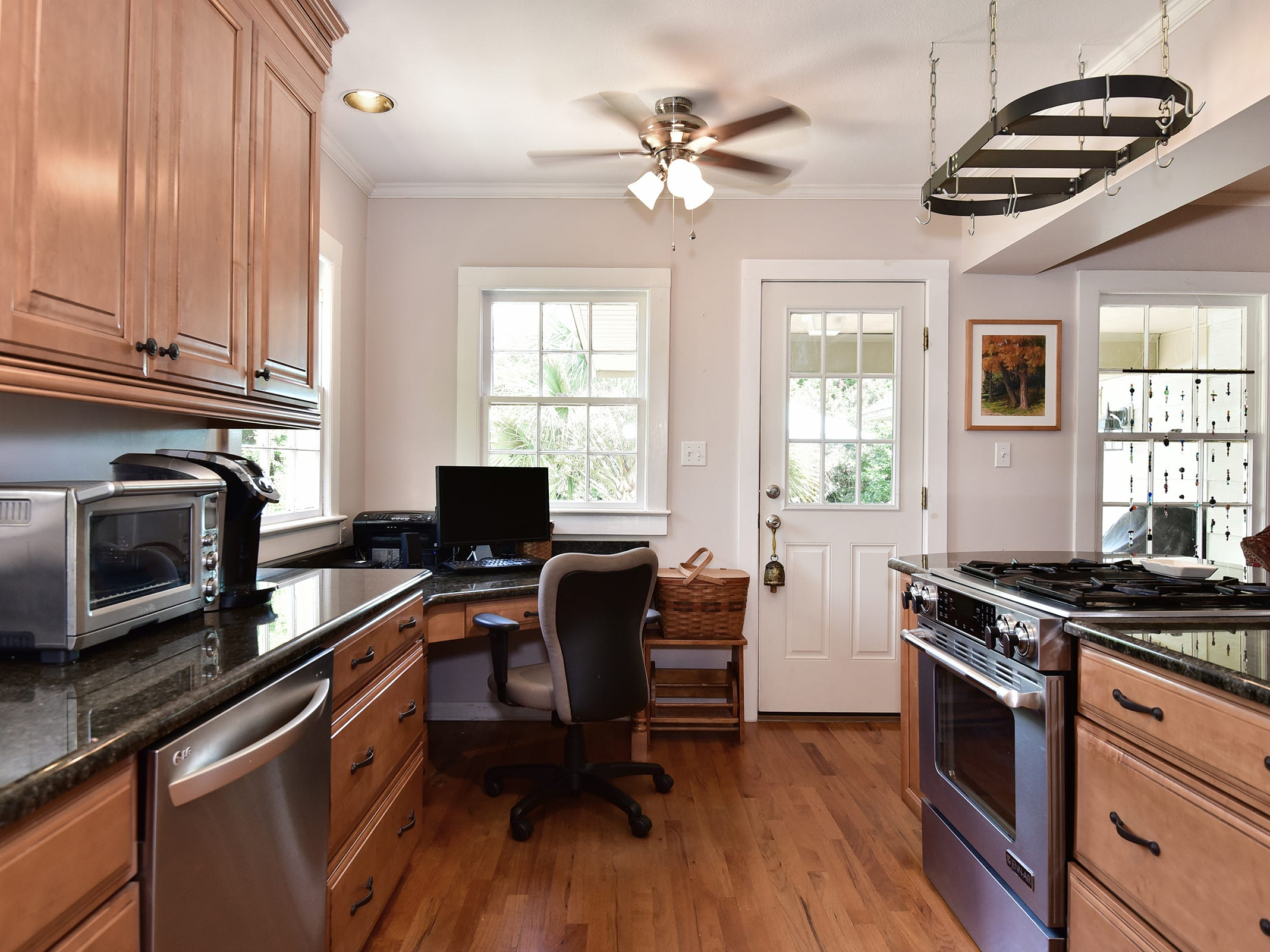 1812 Magnolia Avenue, the kitchen is open overlooks the rear lawn.
