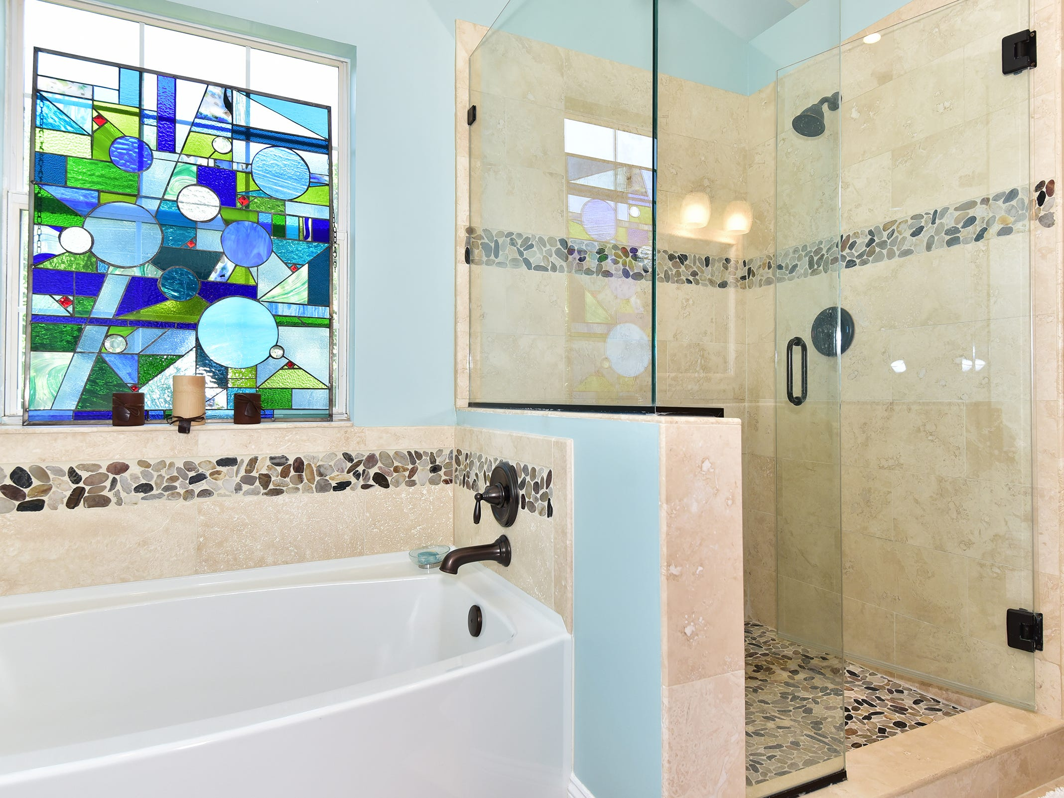 1812 Magnolia Avenue, the master bath includes a deep soaking tub and a walk-in shower.