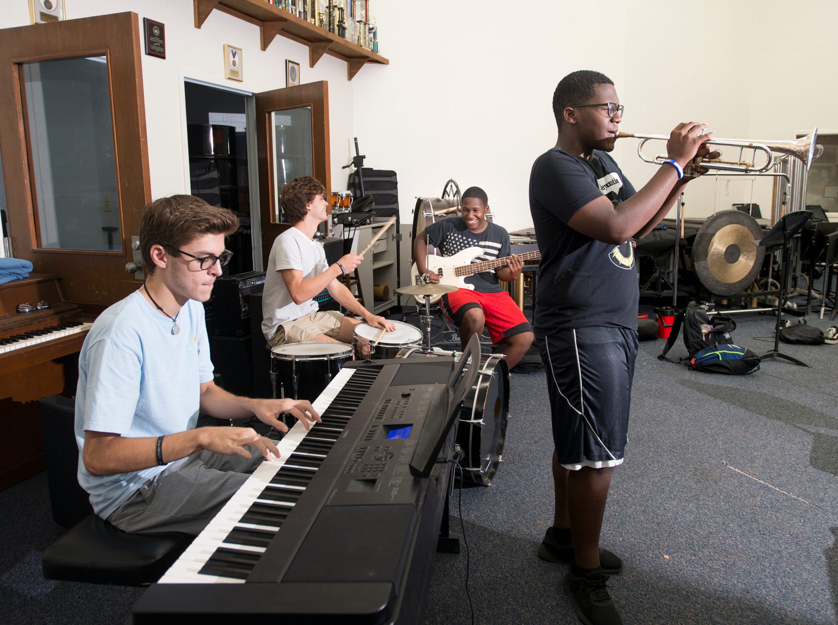 Soul Station jazz band members - keyboardist Bryce Lyublanovits, clockwise from left, drummer Chase Rogers, bass guitarist Andre Conner, and trumpeter Andrew Conner perform in the band room at Booker T. Washington High School in Pensacola on Friday, August 24, 2018.