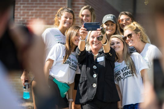 University of West Florida President Dr. Martha Saunders takes a selfie with student volunteers on Friday, Aug. 23, 2018.
