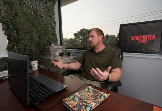 Army veteran Matthew Jeffries, works on his new Warfighter Fitness app at Pensacola CO:Lab on Friday.