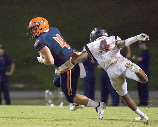 Noah Lord (4) tries to slip past Jaguars defender Antarrius Moultrie (4) during the West Florida vs Escambia football game at Escambia High School in Pensacola on Thursday, August 23, 2018.