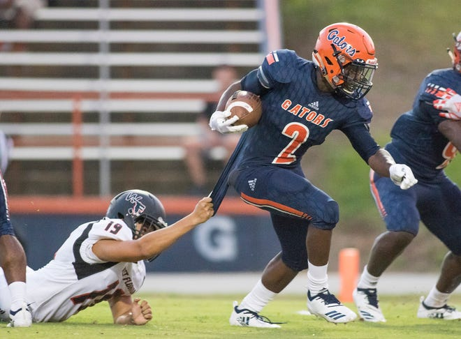 Patrick Sanders (2) slips past the Jaguar defense on his way to score a touchdown increasing their lead to 12-0 during the West Florida vs Escambia football game at Escambia High School in Pensacola on Thursday, August 23, 2018.