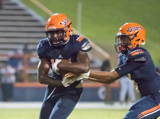 Escambia running back Frank Peasant (1) is one of 10 recruits from the Pensacola area to keep an eye on this summer.