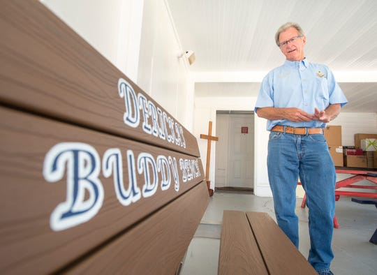 Harry Boyette talks about Dericka's buddy bench, which was created and donated by several groups including his Mason's Lodge, at St. John the Evangelist Catholic School in Warrington on Friday, Aug. 24, 2018.