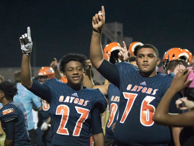 The Gators celebrate their 23-20 victory during the West Florida vs Escambia football game at Escambia High School in Pensacola on Thursday, August 23, 2018.