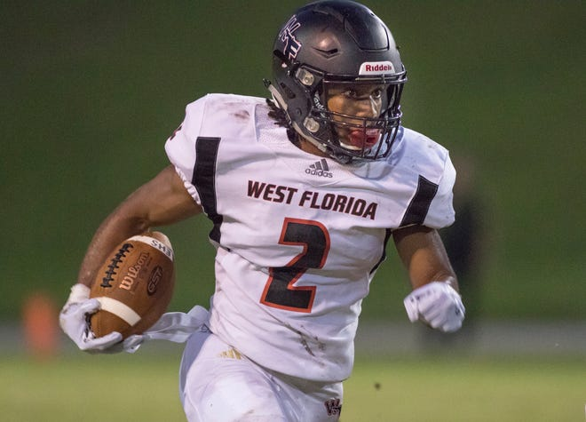 Amir McDaniel (2) carries the ball during the West Florida vs Escambia football game at Escambia High School in Pensacola on Thursday, August 23, 2018.