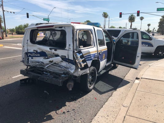 Police SUV rear ended at red light in Phoenix