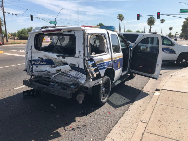 A Phoenix police officer and a prisoner suffered minor injuries when a vehicle rear ended their SUV , which had been stopped for a red light at 79th Avenue and Thomas Road on August 24, 2018.
