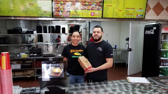 Juan Tenorio Jr. and wife Zamahi inside their new Filiberto's at Brown and Higley roads in Mesa.