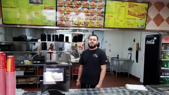 Juan Tenorio Jr. stands behind the counter at Filiberto's at Brown and Higley roads in Mesa. He and wife Zamahi (not pictured) opened the restaurant in August.