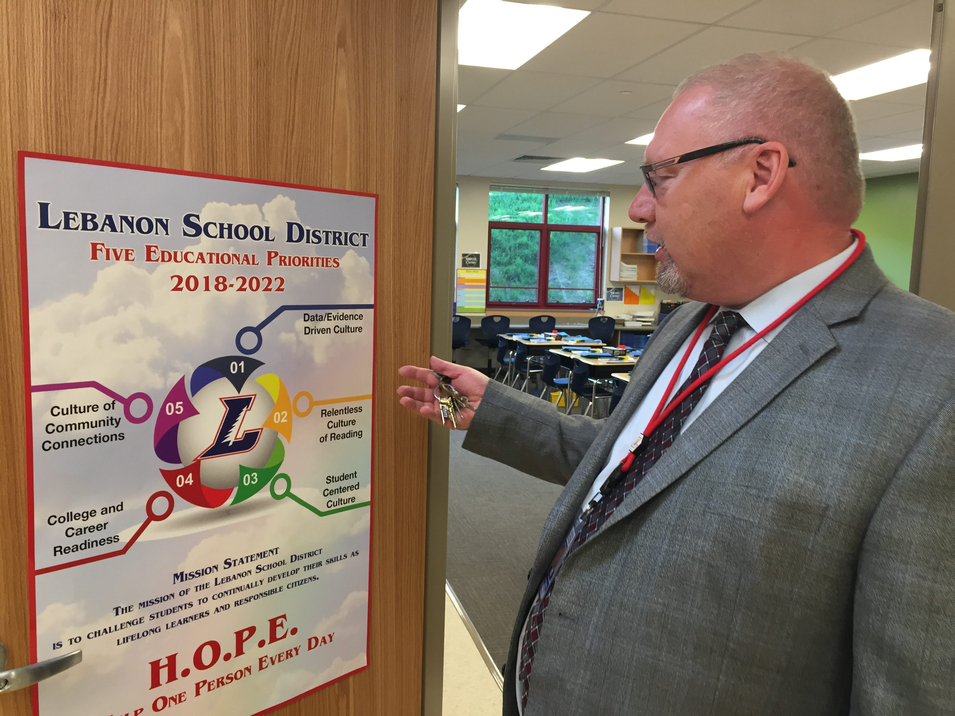 Shawn Canady, chief information officer at Lebanon School District, discussing how the district's five educational priorities are represented in the new Northwest Elementary School building during an open house Aug. 23, 2018.